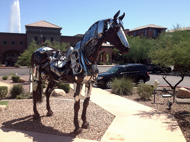 This horse sculpture in just off Saguaro Boulevard in Fountain Hills. You can see the town's famous fountain in action behind it.