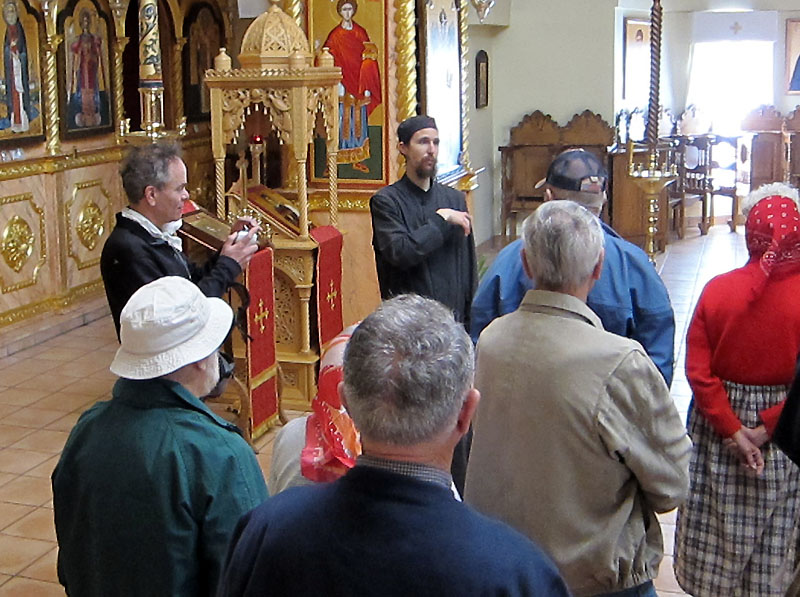 A briefing from a tour guide monk inside the largest church