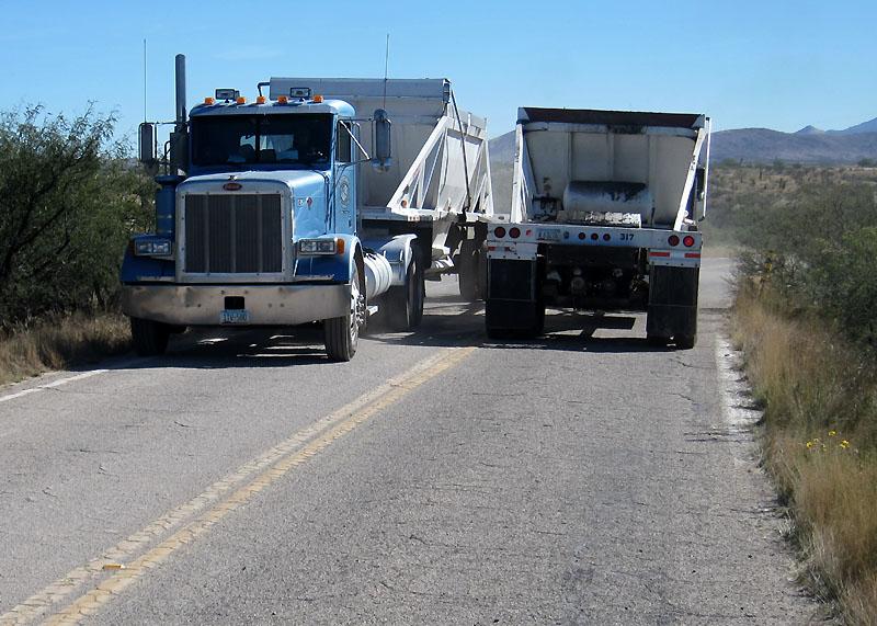 Heavy gravel trucks rolled all morning on Marsh Station Rd.